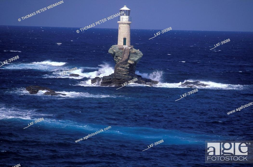 Stock Photo: Lighthouse on little island, near Chora, Andros, Cyclades, South Aegean, Greece.