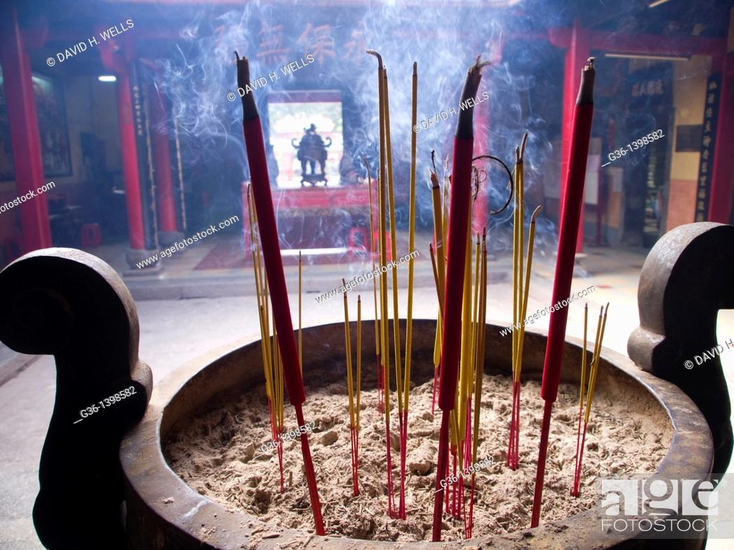 Stock Photo: Incense burns in Buddhist temple in Ho Chi Minh City, Vietnam.
