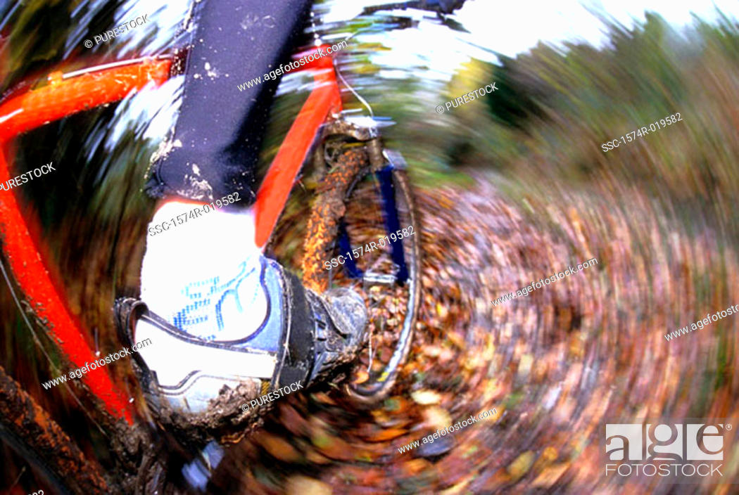 Stock Photo: Low section view of a person mountain biking.