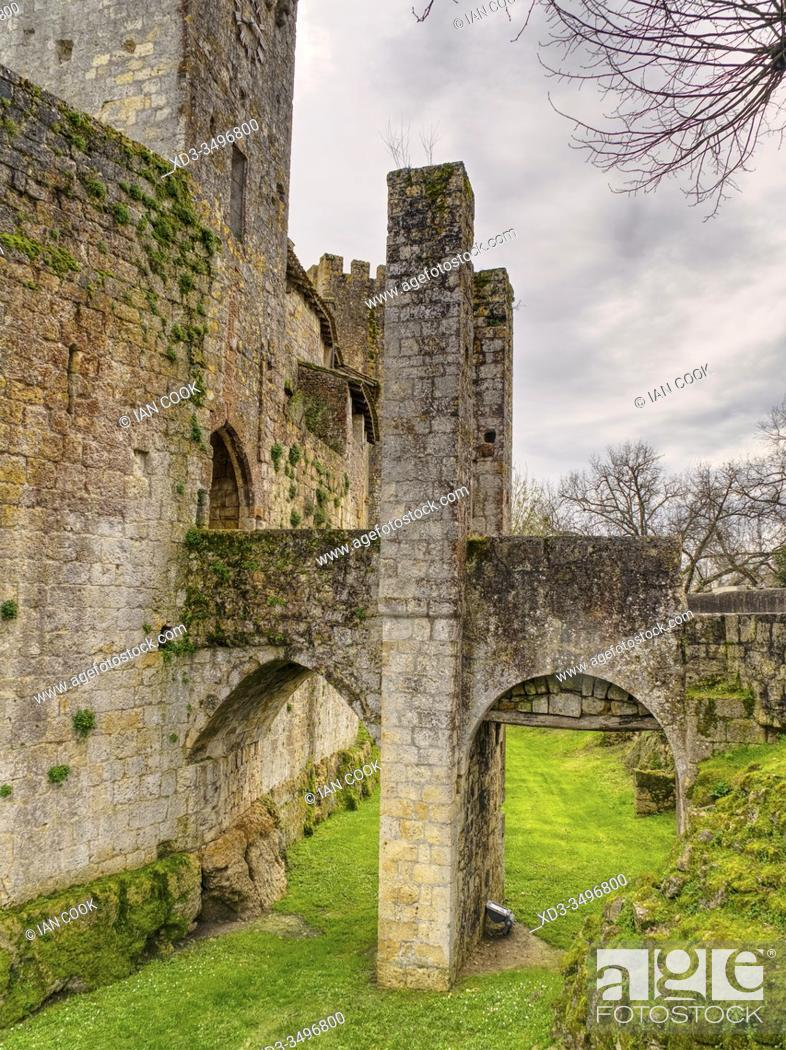 Stock Photo: bridge over former moat at medieval fortified village of Larressingle, Gers Department, Nouvelle Aquitaine, France.