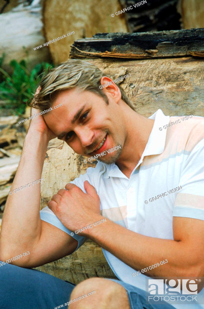 Stock Photo: Young man smiling.