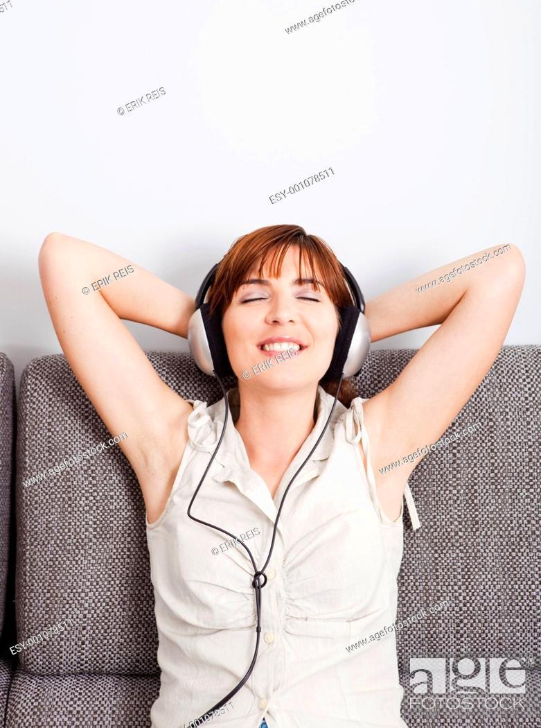 Stock Photo: Listening music.