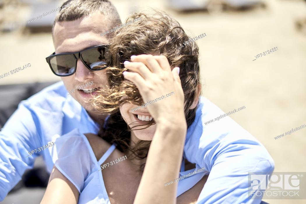 Stock Photo: man embracing woman, on sunbeds, vacations, love, affair, sensual, couple, flirt, summer.