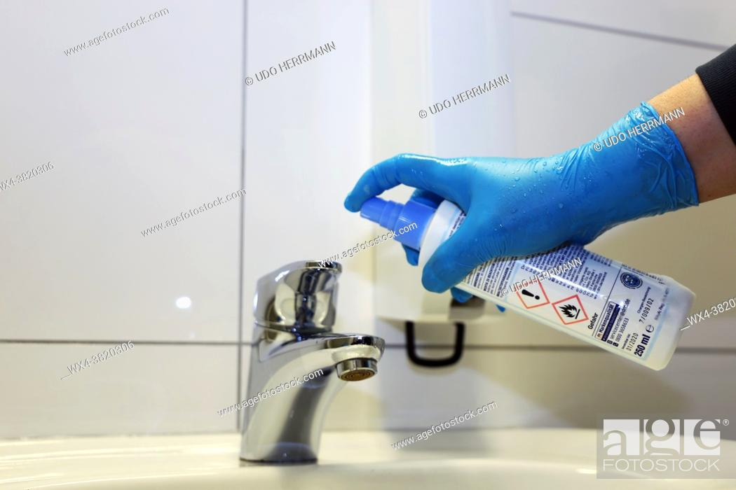 Stock Photo: Cleaning and disinfection of a wash basin.