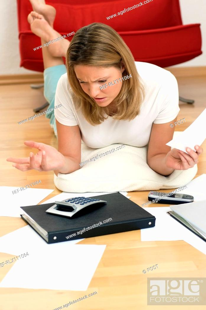 Stock Photo: Woman doing home finances.