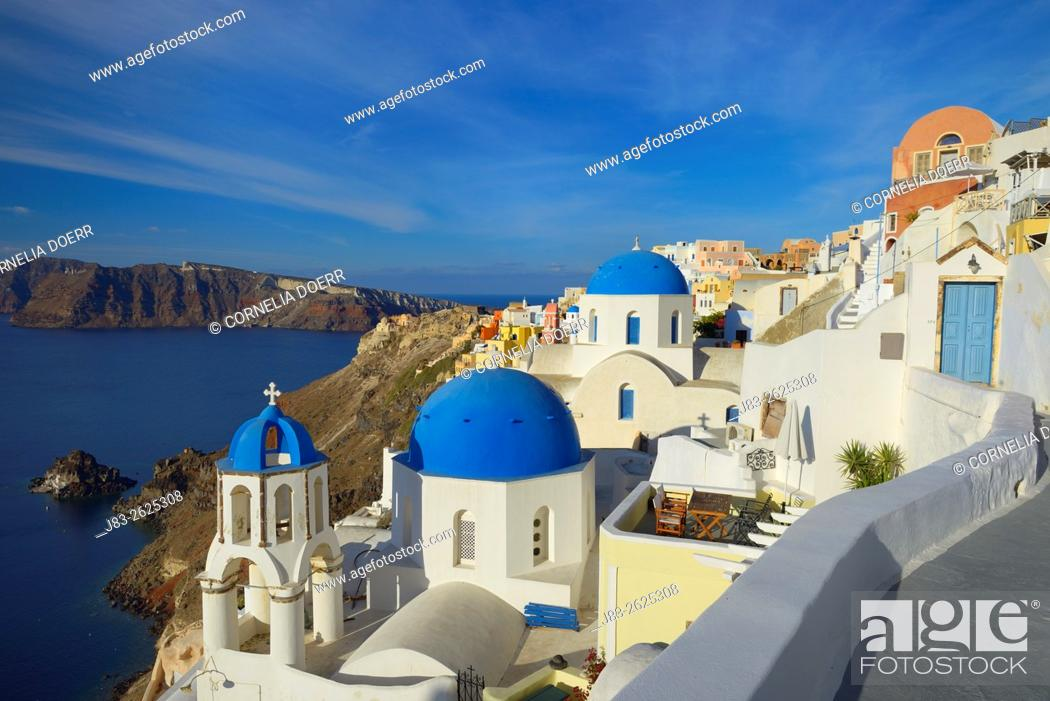 Stock Photo: Blue domes of church in Oia village, Santorini, Aegean Island, Cyclades Island, Greek Islands, Greece, Europe.