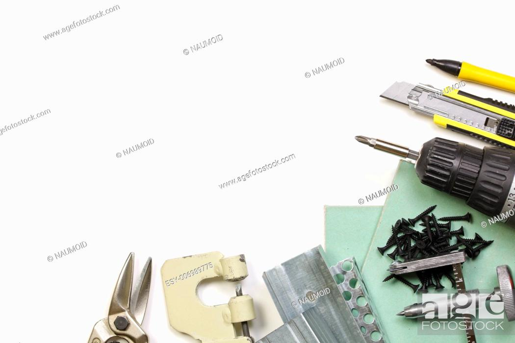 Stock Photo: Plasterboard tools set with metal studs, screws, screwgun, cutter, punch lock crimper and tin snip cutter on white background.