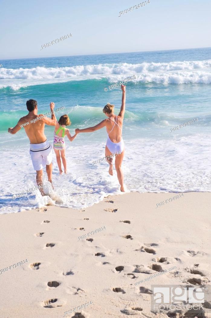 Stock Photo: Family enjoying vacations on the beach.