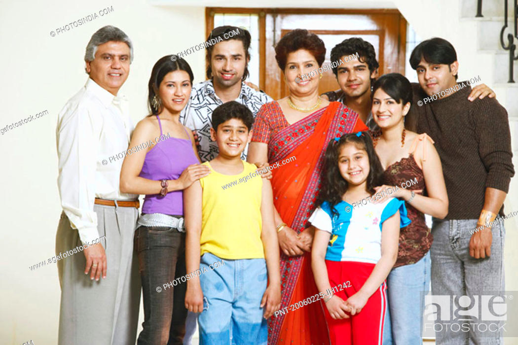 Stock Photo: Portrait of a family standing together.