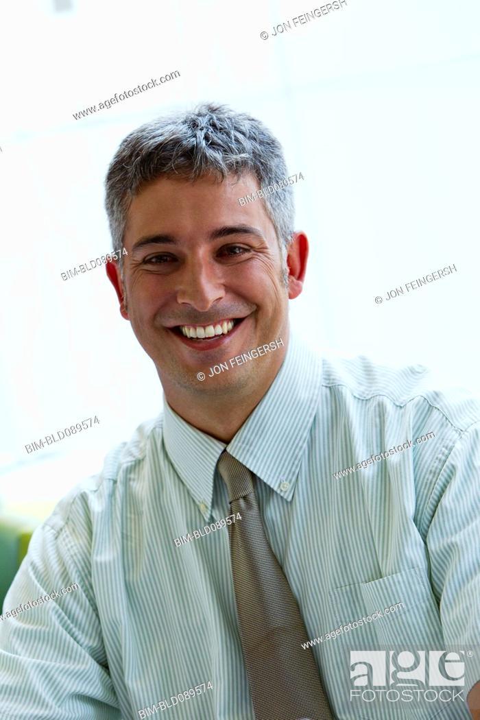 Stock Photo: Smiling businessman.