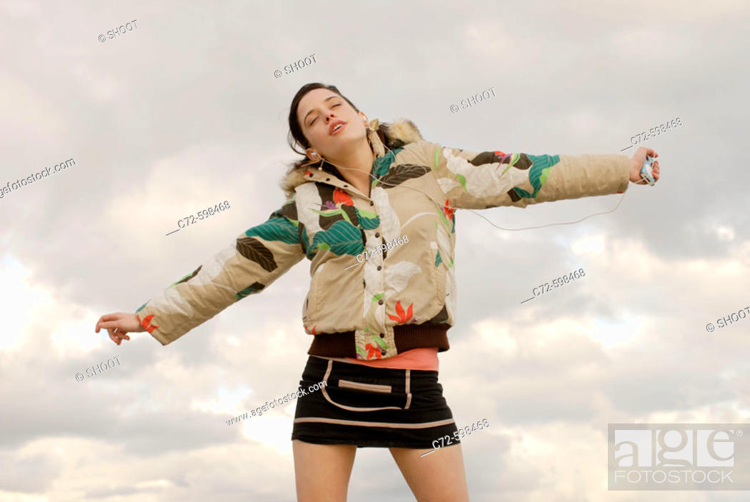 Stock Photo: Young woman outdoors.