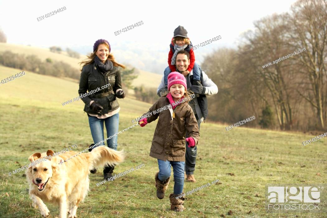 Stock Photo: Family and dog on country walk in winter.