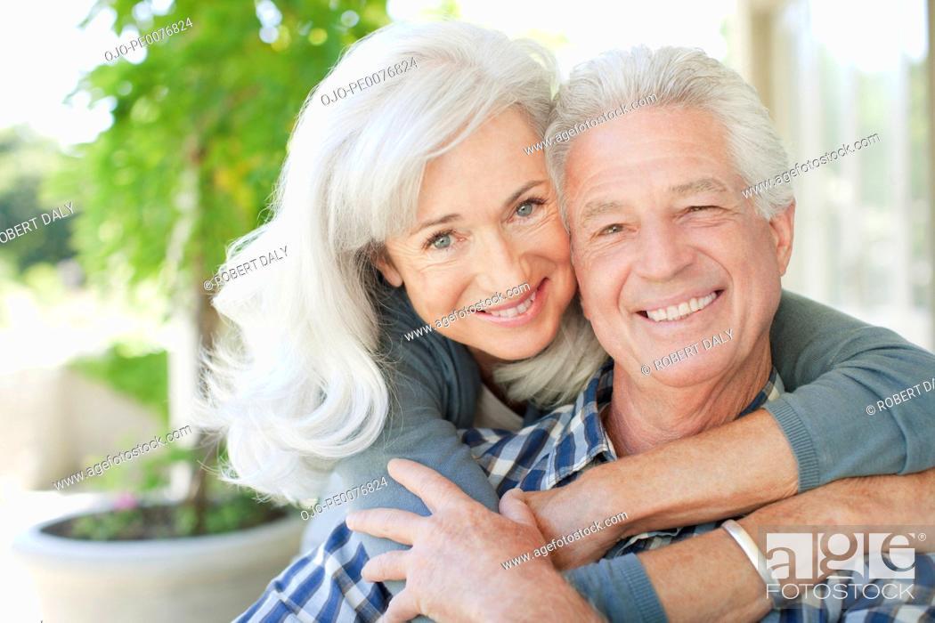 Stock Photo: Senior couple hugging.