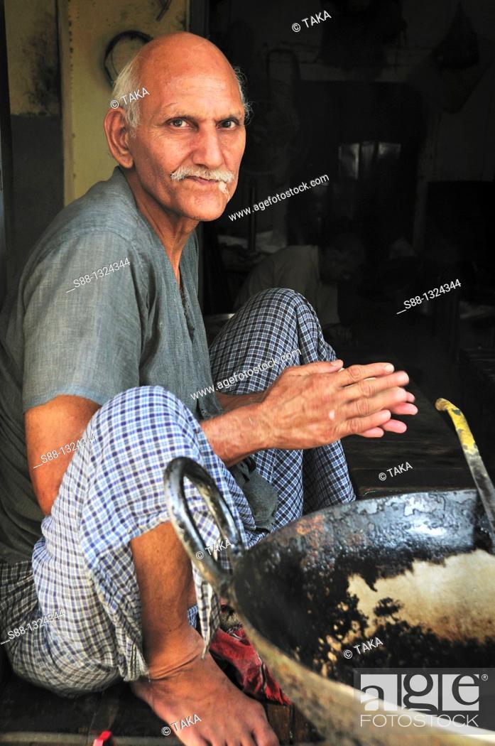 Stock Photo: The man making Puri at the local restaurant, Punjab Amritsar India.