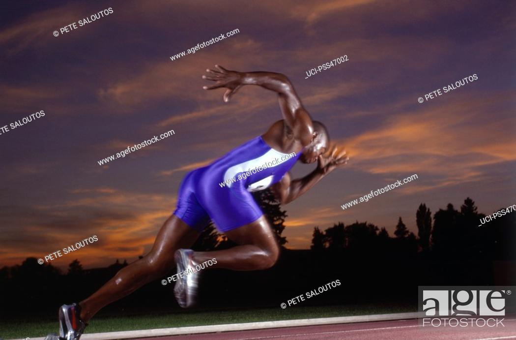 Stock Photo: Male athlete running on track.