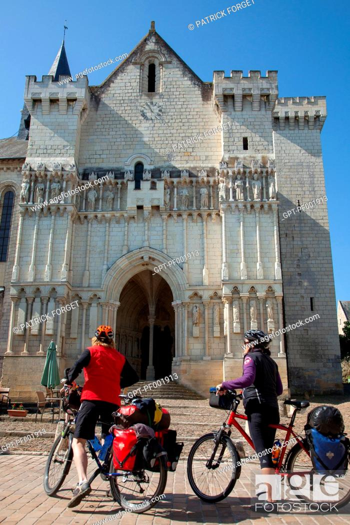 Stock Photo: CYCLISTS IN FRONT OF THE COLLEGIATE CHURCH OF CANDES-SAINT-MARTIN, 'LOIRE A VELO' CYCLING ITINERARY, INDRE-ET-LOIRE 37, FRANCE.