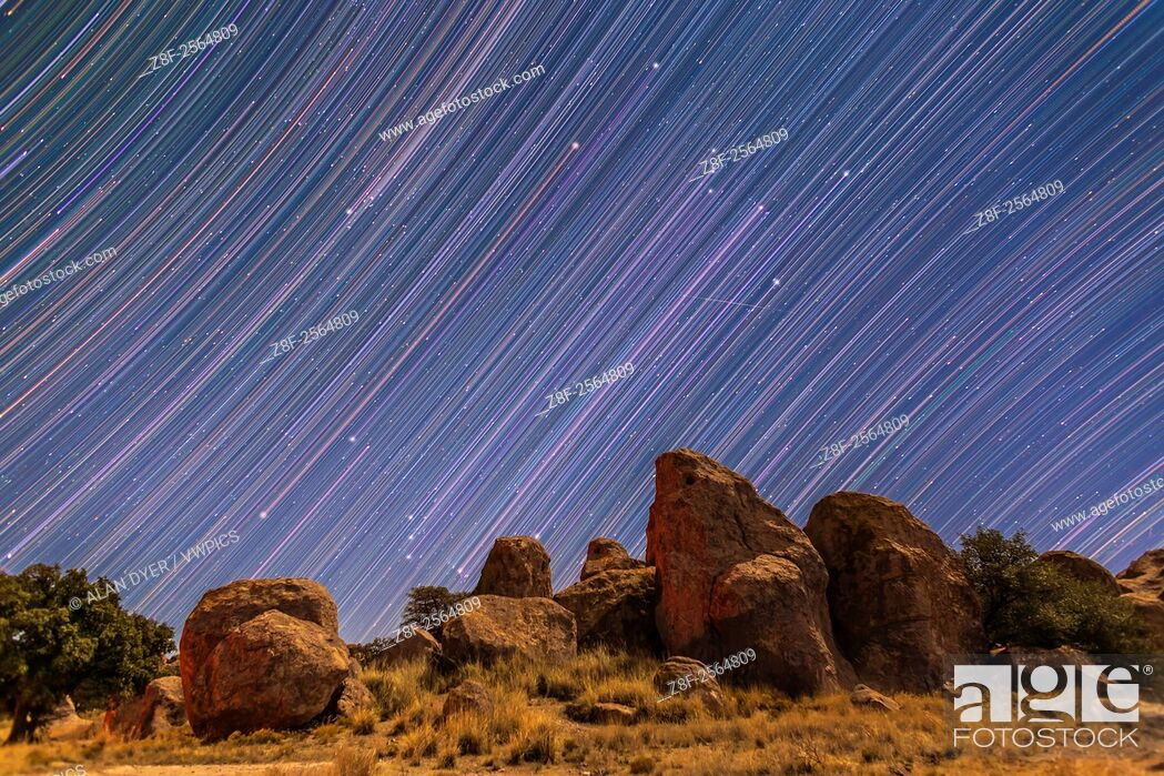 Stock Photo: Star trails showing Orion and Taurus rising behind the rock formations of City of Rocks State Park, New Mexico. I shot this Monday, Dec 29, 2014.