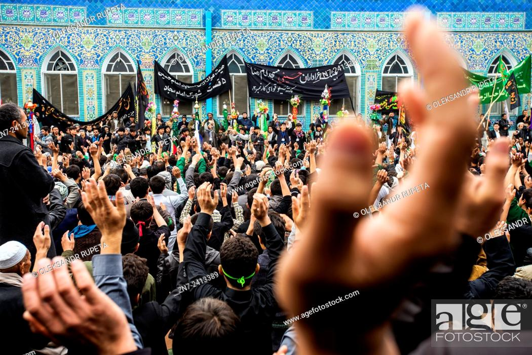 Stock Photo: Shia Muslims listening the festive sermon and beating themselves in front of the Mausoleum the Shrine of Ali in the Day of Ashura.