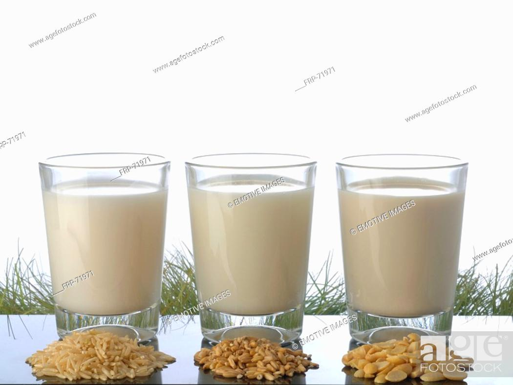Stock Photo: Three glasses of milk and different kinds of grain.