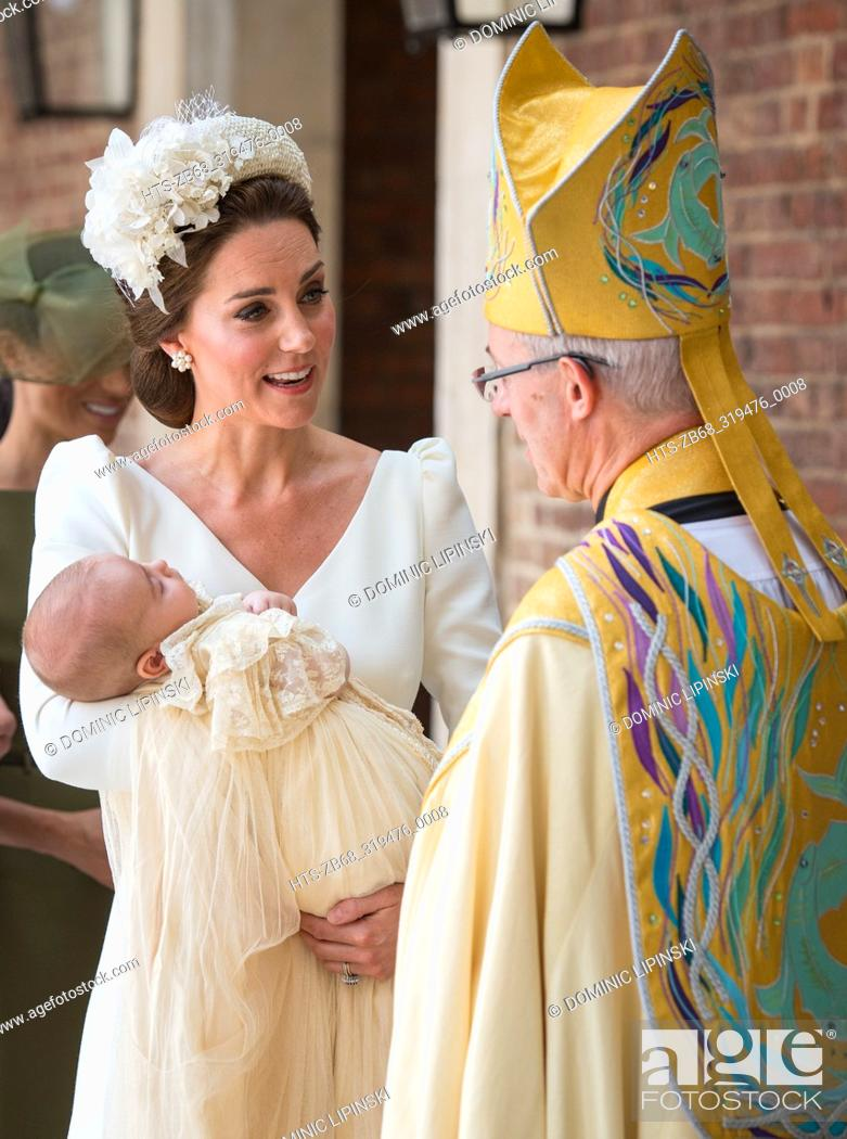 Stock Photo: The Duchess of Cambridge speaks to Archbishop of Canterbury Justin Welby as she arrives carrying Prince Louis for his christening service at the Chapel Royal.