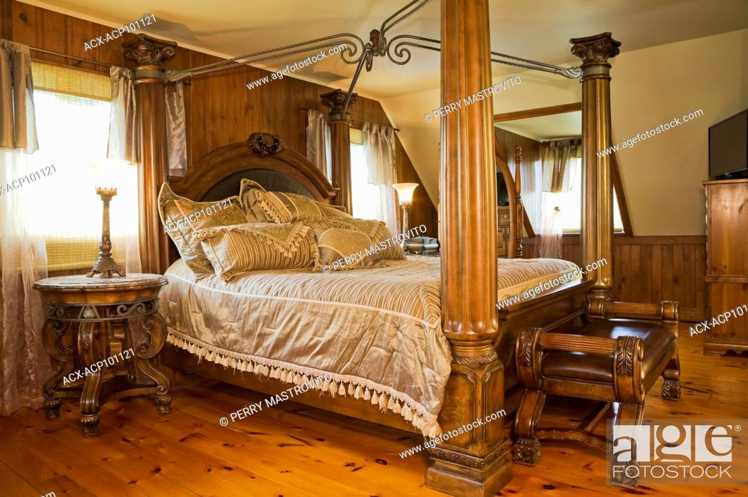 Picture of: Antique King Size Canopy Bed And Roll Arms Bench In The Master Bedroom On The Upstairs Floor Inside Stock Photo Picture And Rights Managed Image Pic Acx Acp101121 Agefotostock