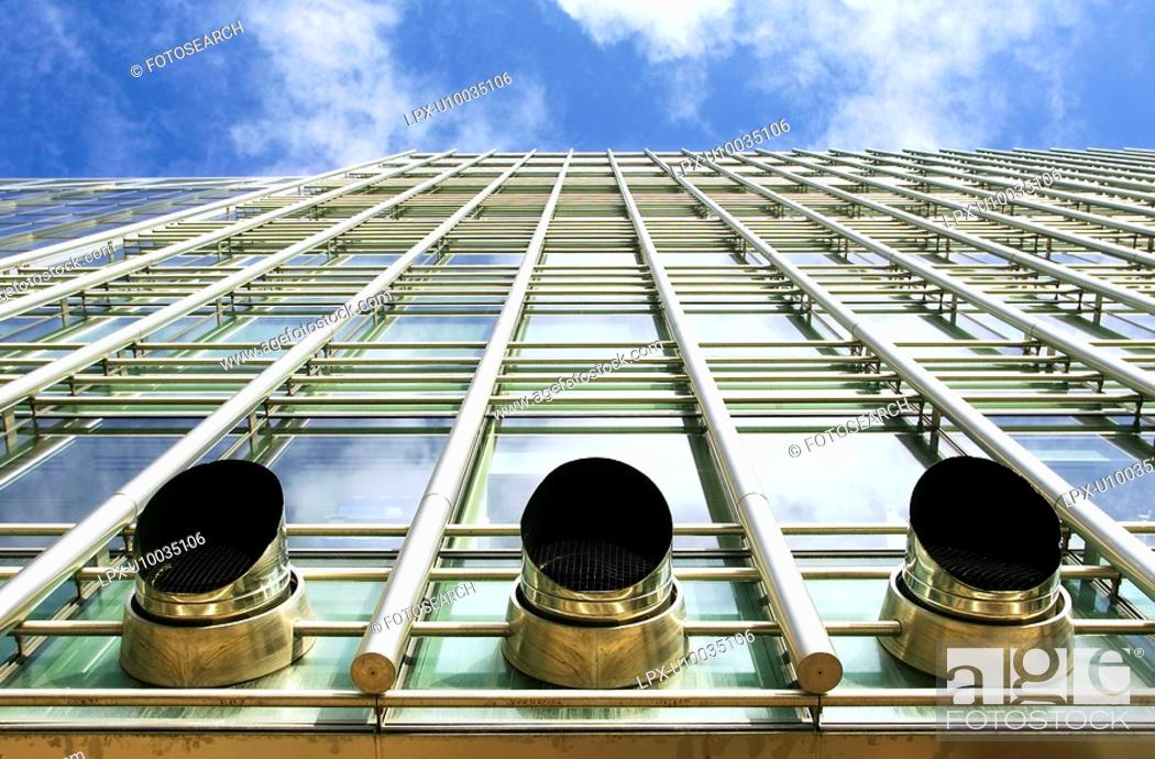 Stock Photo: Exhaust ventilation pipes sticking out from the facade of a modern office building.