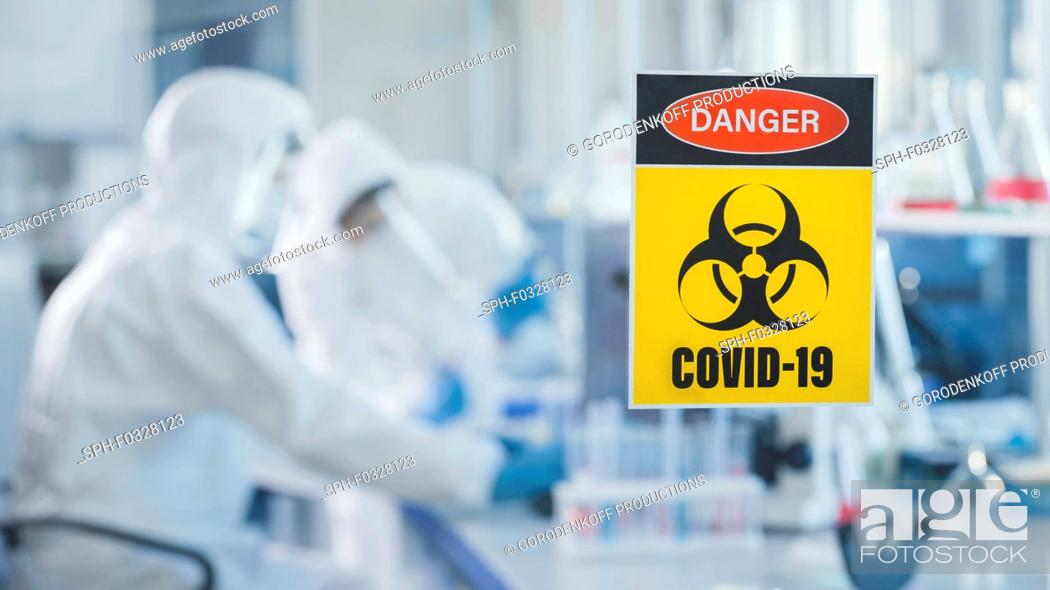 Stock Photo: Team of scientists working in a laboratory.