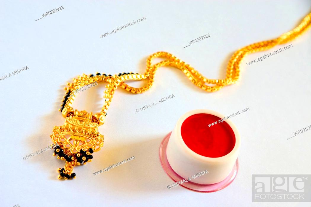 Concept , gold and black beads necklace mangalsutra and sindoor or