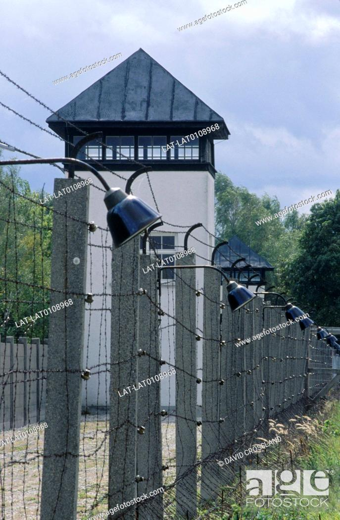 Stock Photo: Watchtower and fence at a Nazi concentration prison camp in World War Two.