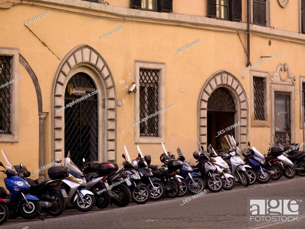 Stock Photo: Motorcycles parked in front of old building, Rome, Italy.