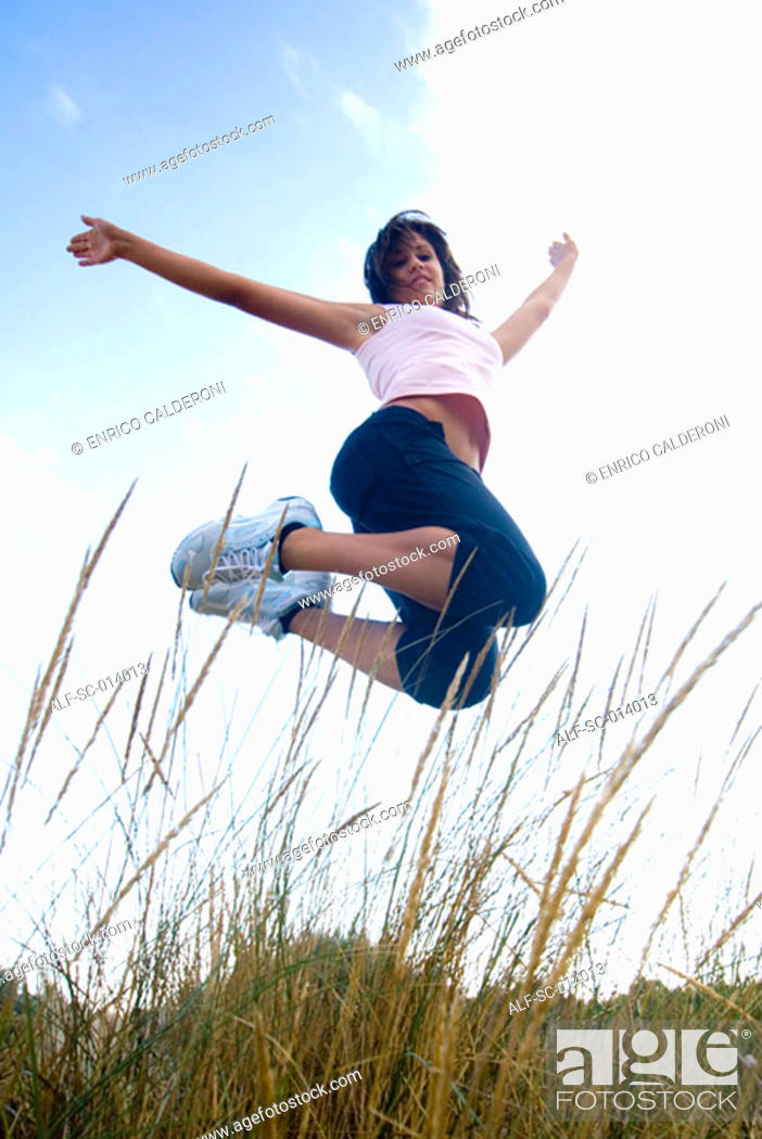 Stock Photo: Young woman jumping.