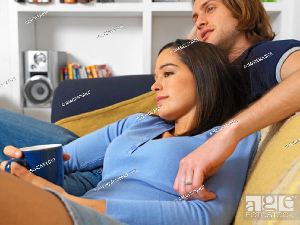 Stock Photo: Couple relaxing on sofa.