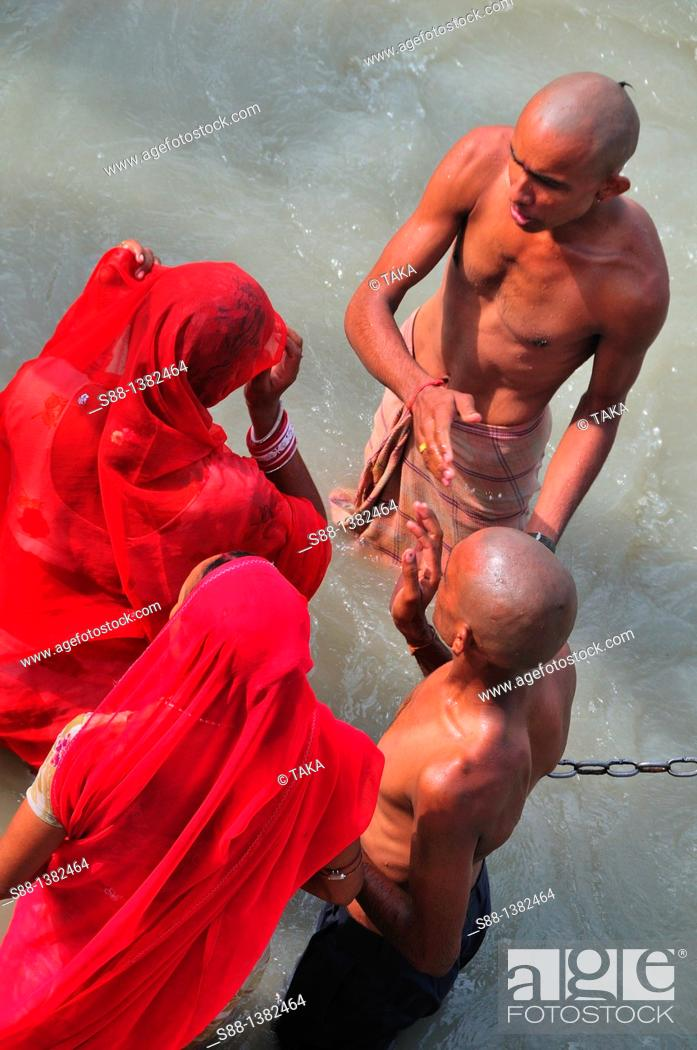Stock Photo: Pilgrims bathing at Har Ki Pairi ghat by the Ganges river.