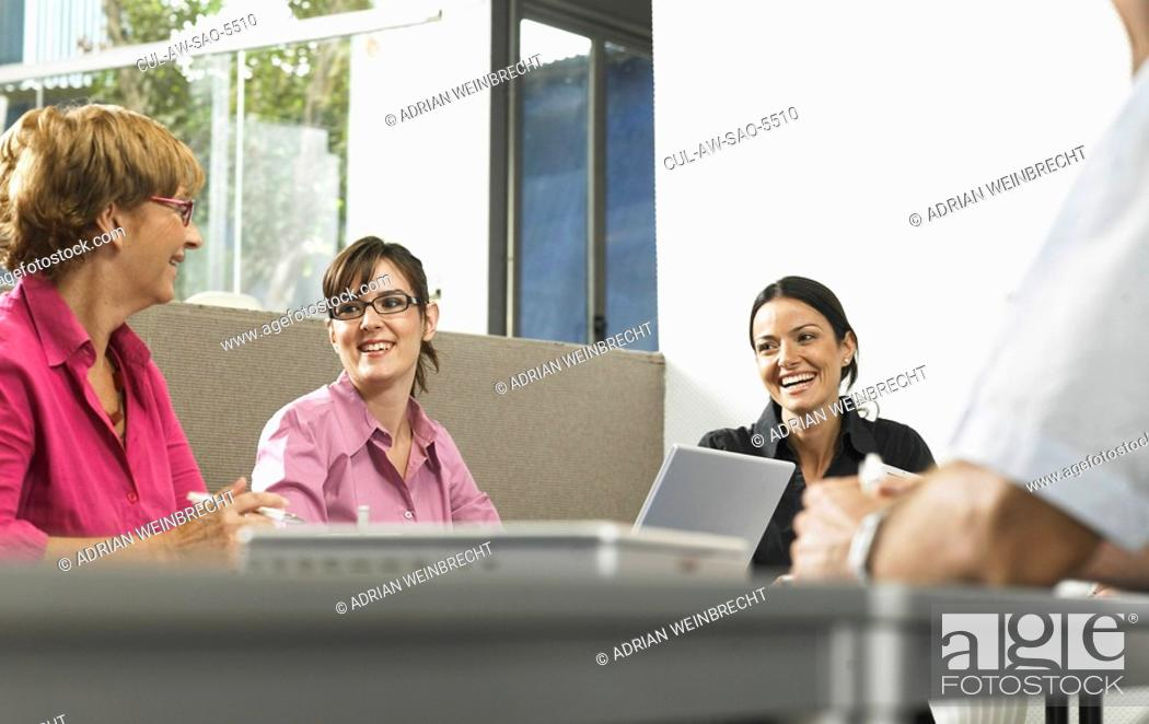 Stock Photo: Businesspeople in a meeting.