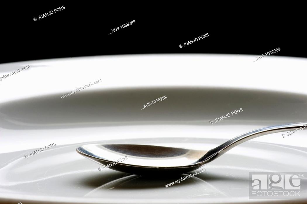 Stock Photo: Dish and spoon.