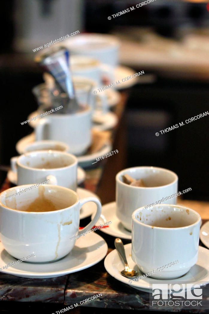 Stock Photo: Dirty coffee cups on counter.