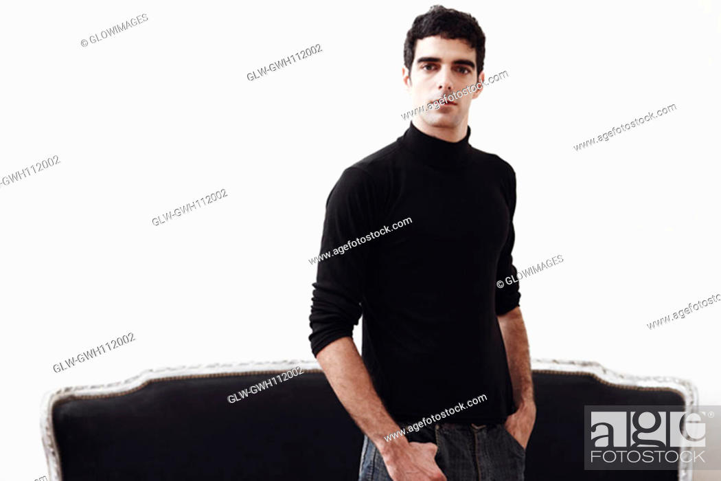 Stock Photo: Portrait of a young man standing with his hands in his pockets.