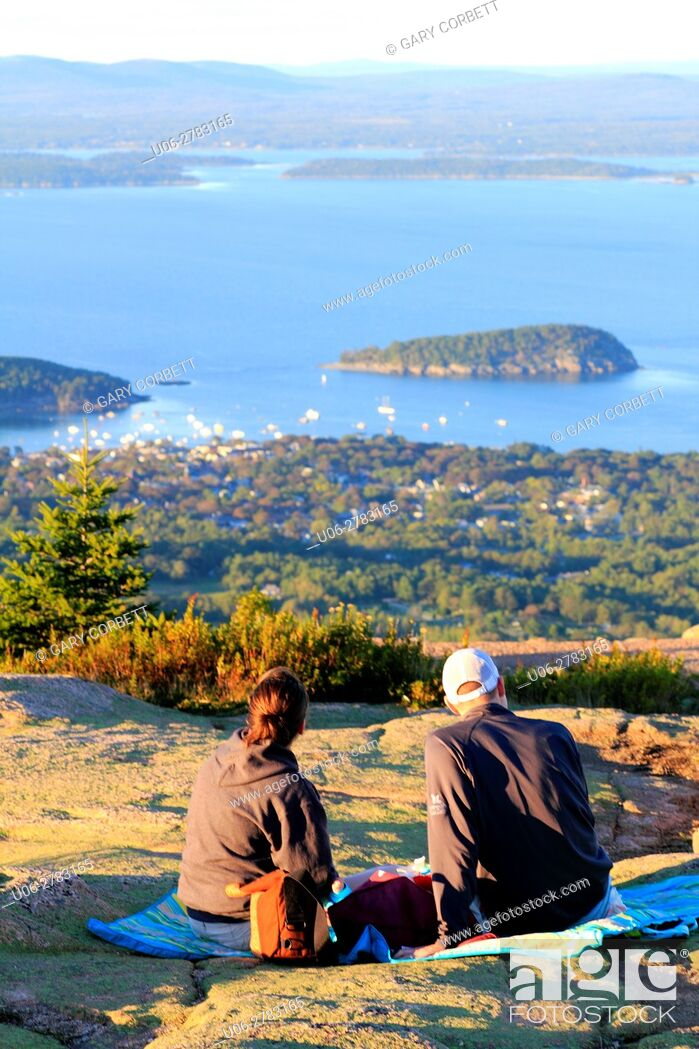 Stock Photo: A couple sitting on a blanket enjoying the view of Bar Harbor from Cadillac Mountain Maine USA.