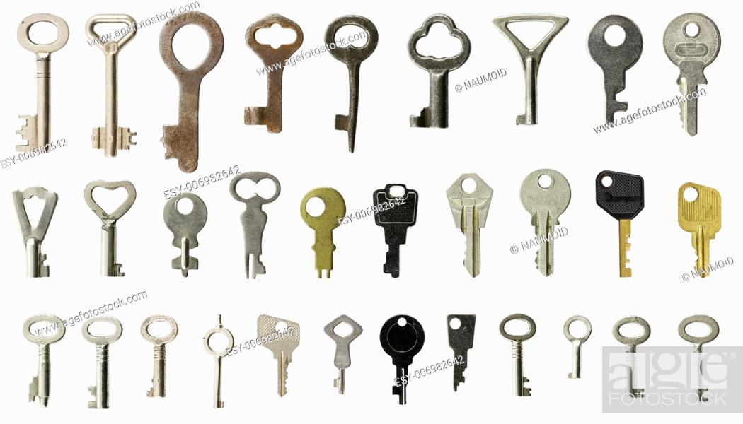 Imagen: Collection of old keys on white background.