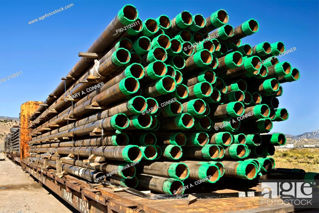 Stock Photo: Stacked drill pipe on rail cars in Colorado.