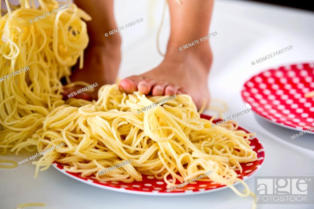 Stock Photo: Germany, Girl standing in spaghetti.