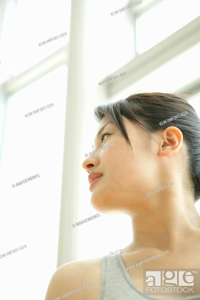 Stock Photo: Low angle view of a young woman wearing workout suit.
