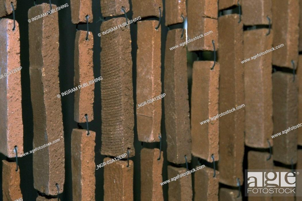 Stock Photo: Close-up of stone bricks hanging with wire.