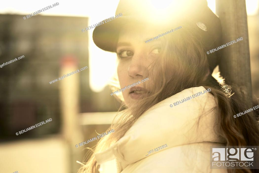 Stock Photo: young woman in sunlight, in city Cottbus, Brandenburg, Germany.