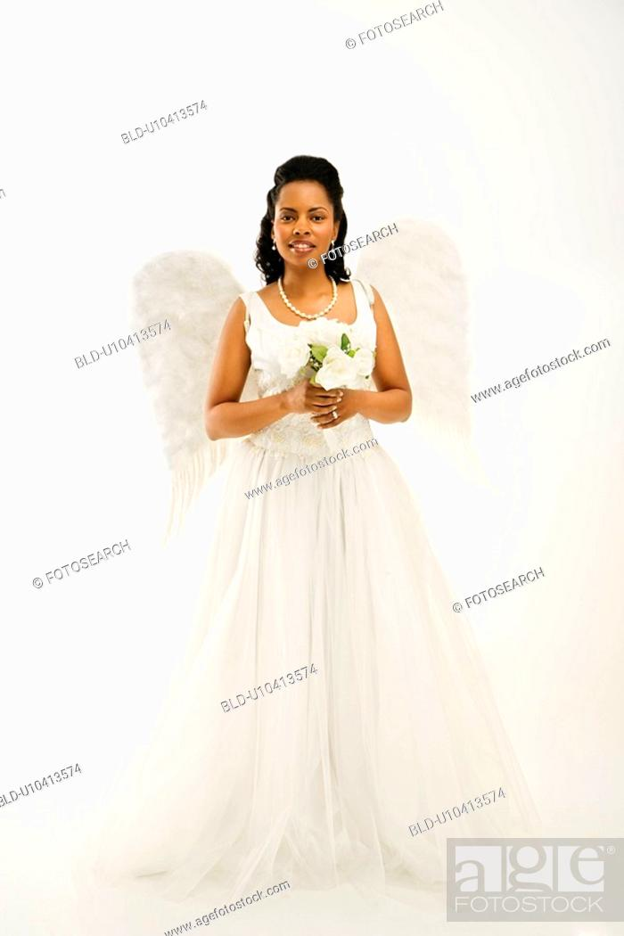 Stock Photo: Angelic mid-adult African-American bride holding a bouquet on white background.