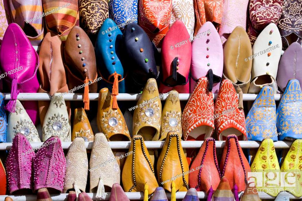 Imagen: Morocco Marrakesh Place Djemaa el-Fna Berber shoes for sale in the market.