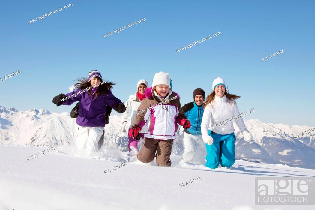 Stock Photo: Happy family running in snow.