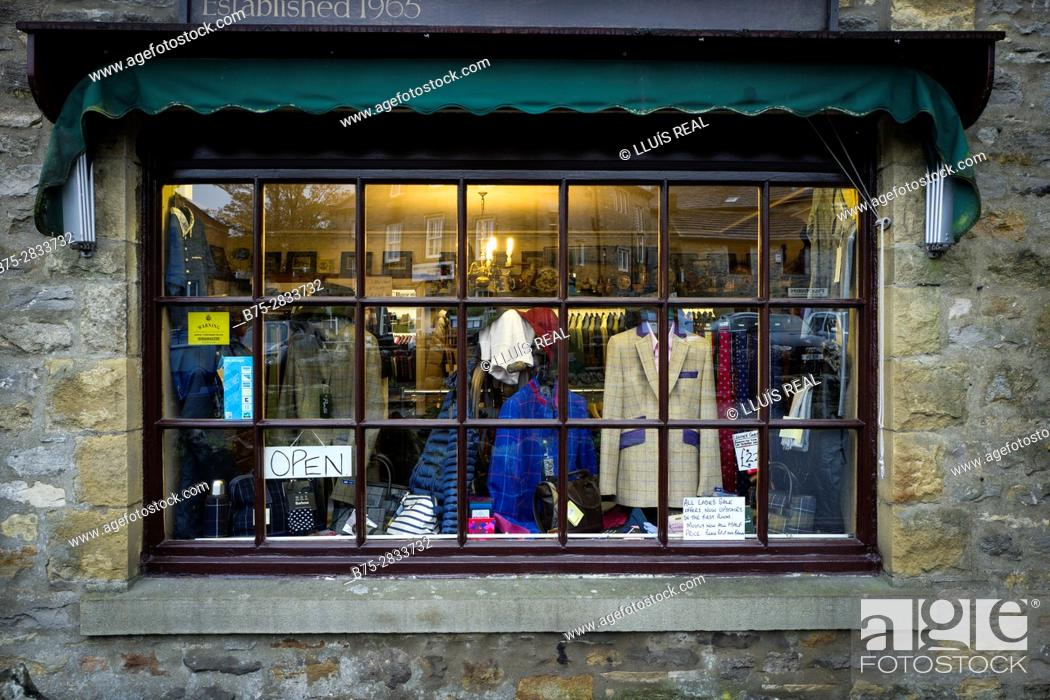 b06dd510b53 Stock Photo - Shop window of a traditional English clothing store with the