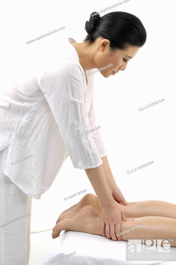 Stock Photo: Close-up of a woman getting leg massage.