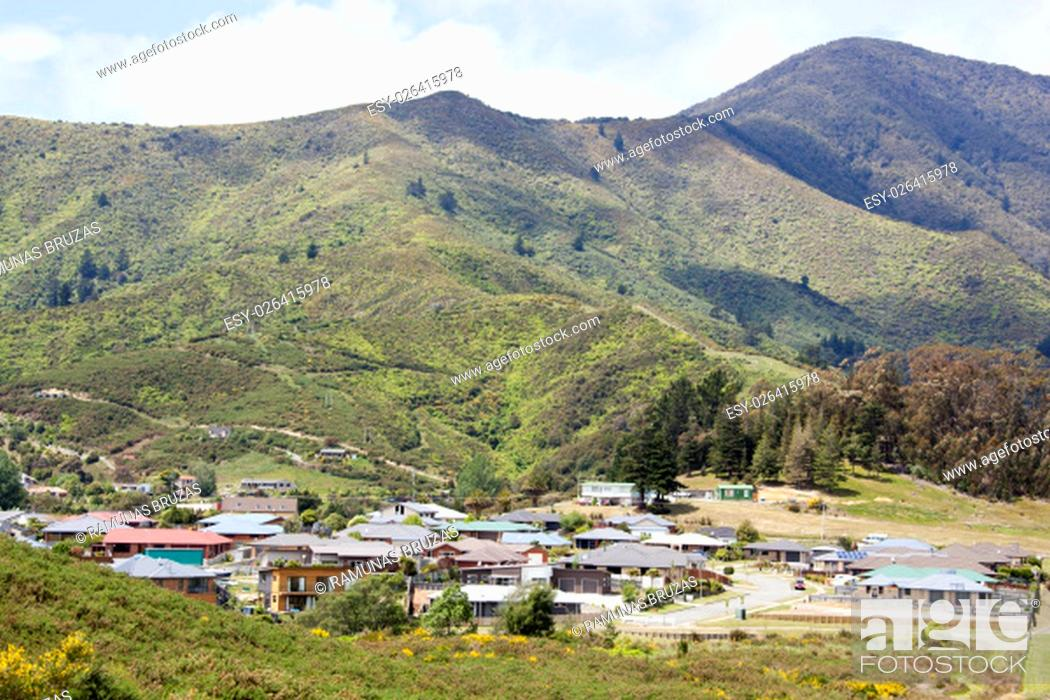 Stock Photo: The view of Picton town residential district surrounded by mountains (New Zealand).